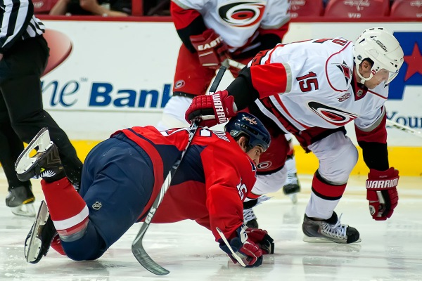 WASHINGTON, DC - March 11, 2011:  Washington Capitals forward Boyd Gordon (#15) wins a faceoff against Carolina Hurricanes forward Tuomo Ruutu (#15) during their NHL ice hockey game at Verizon Center.