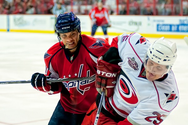 WASHINGTON, DC - March 11, 2011:  Washington Capitals forward Matt Bradley (#10) and Carolina Hurricanes defenseman Joni Pitkanen (#25) during their NHL ice hockey game at Verizon Center.