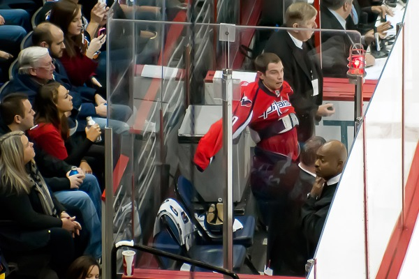 WASHINGTON, DC - November 11, 2010:  Washington Capitals forward Matt Bradley (#10) pulls his jersey back on in the penalty box after a fight against Tampa Bay Lightning forward Adam Hall during their NHL ice hockey game at Verizon Center.