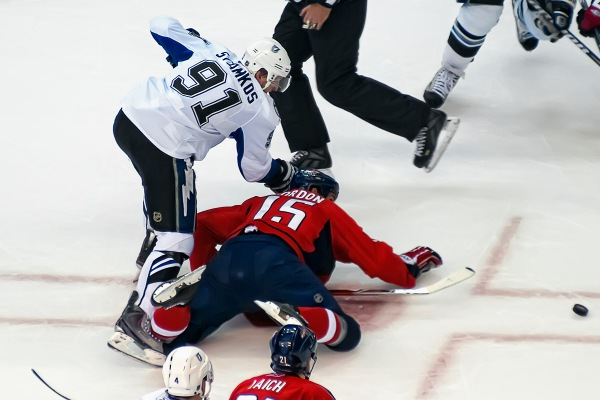WASHINGTON, DC - May 1, 2011:  Washington Capitals forward Boyd Gordon (#15) wins a faceoff against Tampa Bay Lightning forward Steven Stamkos (#91) during Game Two of the Eastern Conference Semifinals NHL playoff series at Verizon Center.