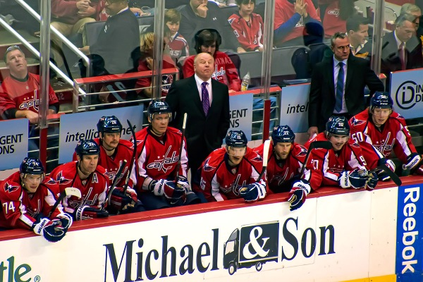 WASHINGTON, DC - November 25, 2011:  Washington Capitals coach Bruce Boudreau closes his eyes behind the bench after a New York Rangers goal during their NHL ice hockey game at Verizon Center.
