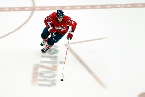 WASHINGTON, DC - November 26, 2010:  Washington Capitals forward Boyd Gordon (#15) skates with the puck during their NHL ice hockey game against the Tampa Bay Lightning at Verizon Center.