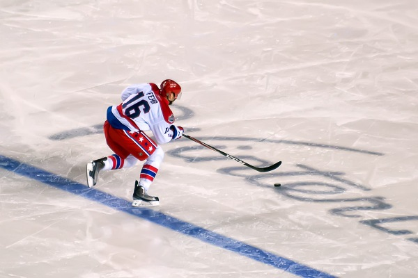 PITTSBURGH, PA - January 1, 2011:  Washington Capitals forward Eric Fehr (#16) skates into the Pittsburgh Penguins zone on a breakaway during the NHL's 2011 New Year's Day Winter Classic ice hockey game at Heinz Field.