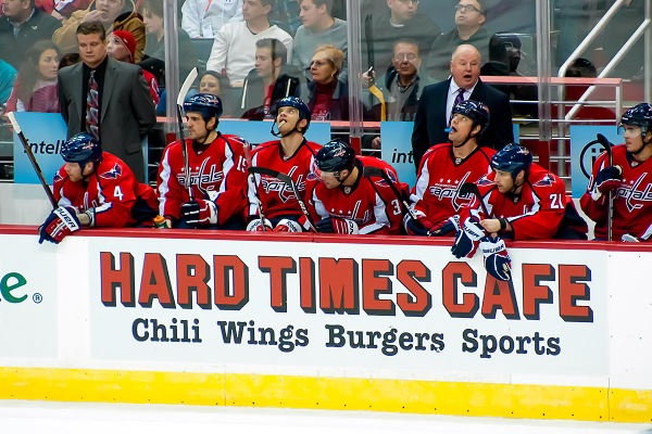 WASHINGTON, DC - February 8, 2011:  Washington Capitals coach Bruce Boudreau yells instructions for his team on the bench during their NHL ice hockey game at Verizon Center against the San Jose Sharks.