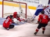 Neuvirth Reaches With Semin's Help