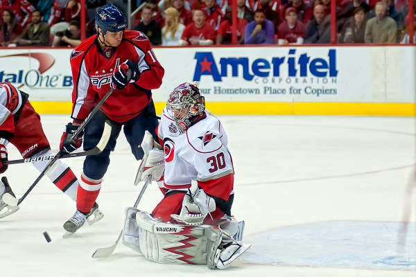 WASHINGTON, DC - March 11, 2011:  Washington Capitals forward Matt Bradley (#10) looks for a rebound off Carolina Hurricanes goalie Cam Ward (#30) during their NHL ice hockey game at Verizon Center.