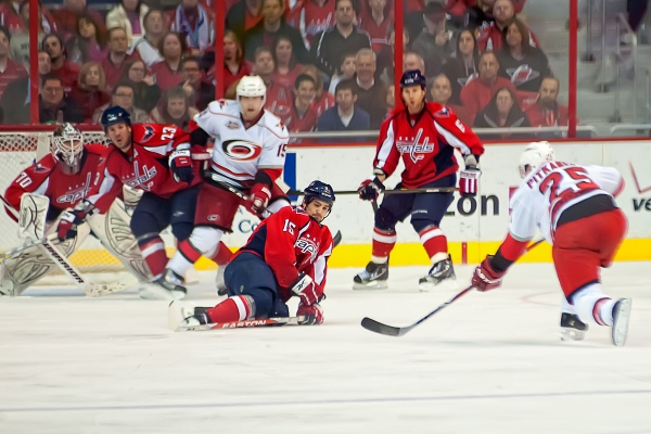 WASHINGTON, DC - March 11, 2011:  Washington Capitals forward Boyd Gordon (#15) blocks a shot by Carolina Hurricanes defenseman Joni Pitkanen (#25) during a Hurricanes power play in their NHL ice hockey game at Verizon Center.