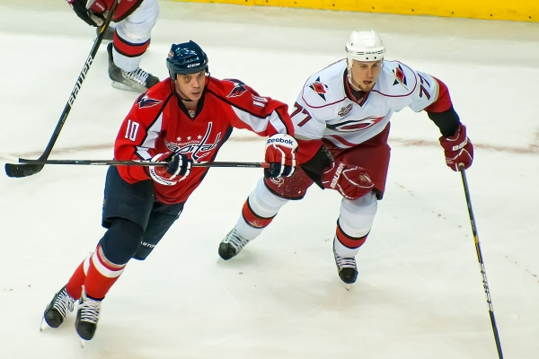 WASHINGTON, DC - March 29, 2011:  Washington Capitals forward Matt Bradley (#10), sporting a black eye, and Carolina Hurricanes defenseman Joe Corvo (#77) during their NHL ice hockey game at Verizon Center.