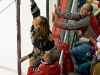 Fan Climbs For Puck