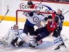 Carlson and Puck Fall in Pavelec\'s Crease
