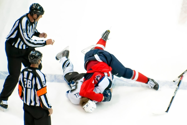 WASHINGTON, DC - November 11, 2010:  Washington Capitals forward Matt Bradley (#10) takes down Tampa Bay Lightning forward Adam Hall (#10) to end their fight during their NHL ice hockey game at Verizon Center.