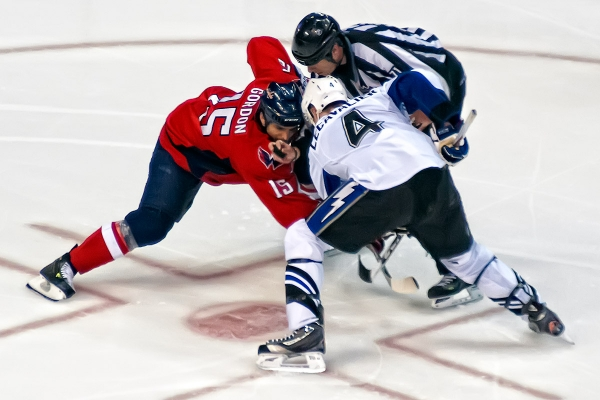 WASHINGTON, DC - May 1, 2011:  Washington Capitals forward Boyd Gordon (#15) and Tampa Bay Lightning forward Vincent Lecavalier (#4) faceoff in overtime of Game Two of the Eastern Conference Semifinals NHL playoff series at Verizon Center.