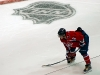 Ovechkin Waits for Faceoff by NHL Logo
