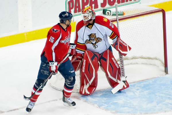 WASHINGTON, DC - December 9, 2010:  Washington Capitals forward Eric Fehr (#16) and Florida Panthers goalie Tomas Vokoun (#29) during their NHL ice hockey game at Verizon Center.