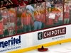 "WASHINGTON, DC - May 5, 2012:  A fan holds a sign reading ""Rangers Are In Danger"" after the Washington Capitals defeated the New York Rangers in Game Four of the Eastern Conference Semifinals of the 2012 NHL Stanley Cup Playoffs at Verizon Center on Cinco De Mayo as sombrero slides along the ice."