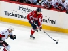 Backstrom Carries the Puck Up Ice