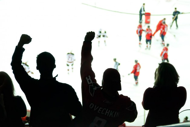 WASHINGTON, DC - December 26, 2009: Fans cheer from the cheap seats in the third period of an NHL ice hockey game at Verizon Center between the Washington Capitals and New Jersey Devils.