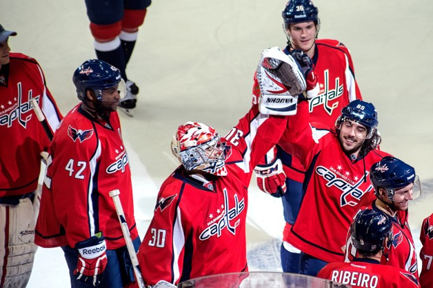 WASHINGTON, DC - January 27, 2013: Washington Capitals goalie Michal Neuvirth (#30) and forward Mathieu Perreault (#85) high five each other after defeating the Buffalo Sabres in their NHL ice hockey game at Verizon Center.
